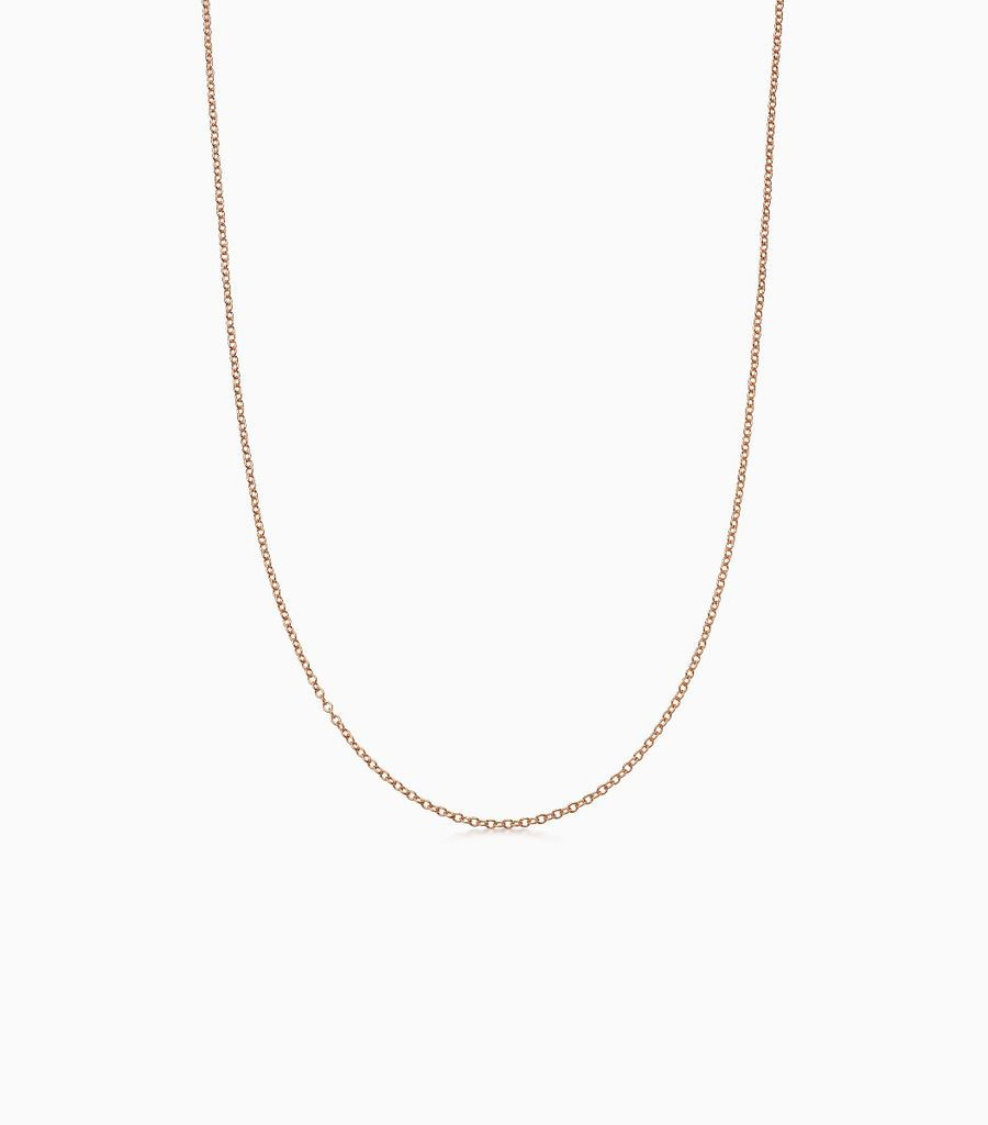 9carat rose gold fine gauge chain, with an adjustible sliding ball, so that the necklace can be worn at either 16 or 18 inches. Logo disk on the back.