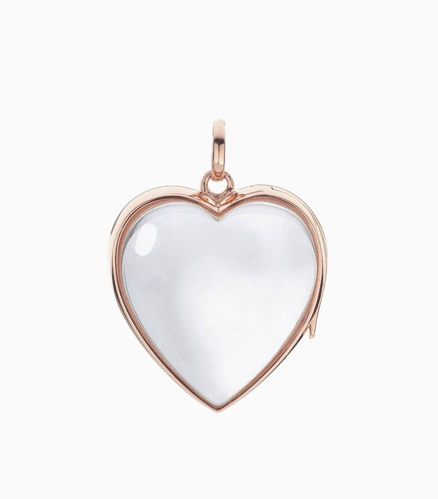 9carat rose gold, heart shaped locket, set with a bevel edged, crystal glass front and a flat crystal glass back. The locket is designed with a side hindge for secure fastening and has a 24mm drop and a 22.5mm width
