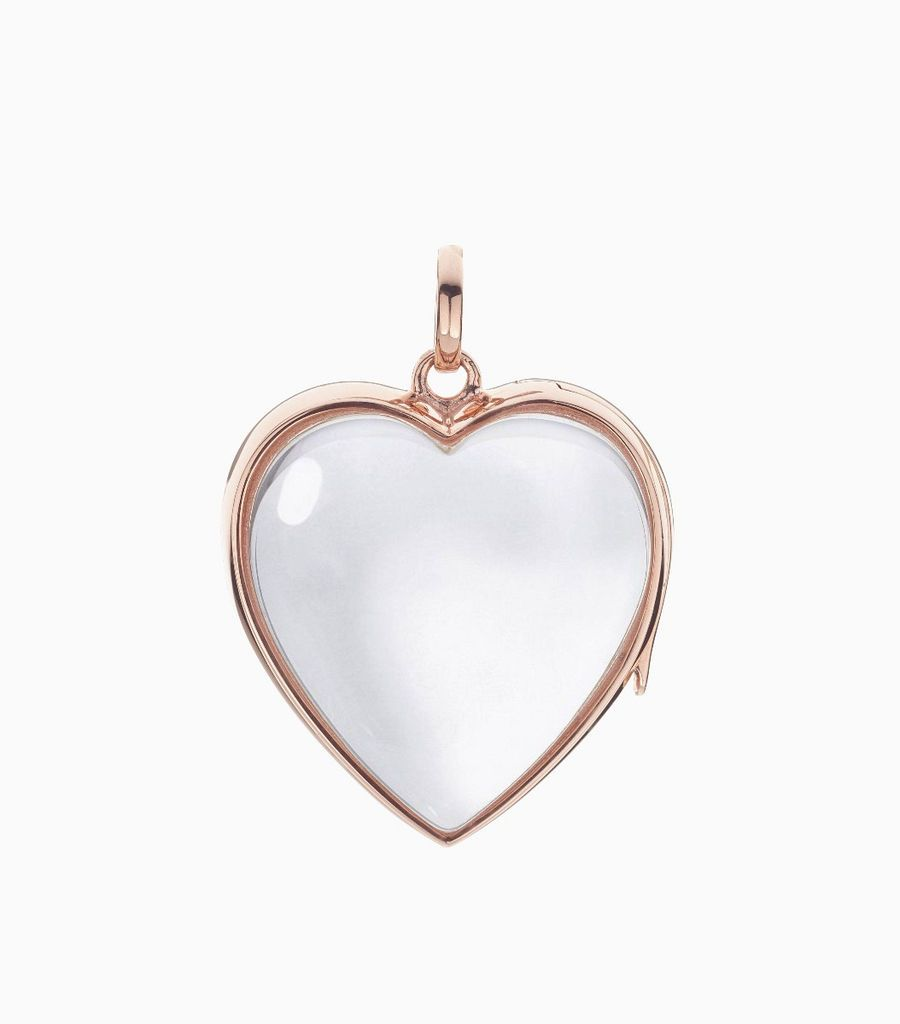 14 carat rose gold, heart shaped locket, set with a bevel edged, crystal glass front and a flat crystal glass back. The locket is designed with a side hindge for secure fastening and has a 24mm drop and a 22.5mm width