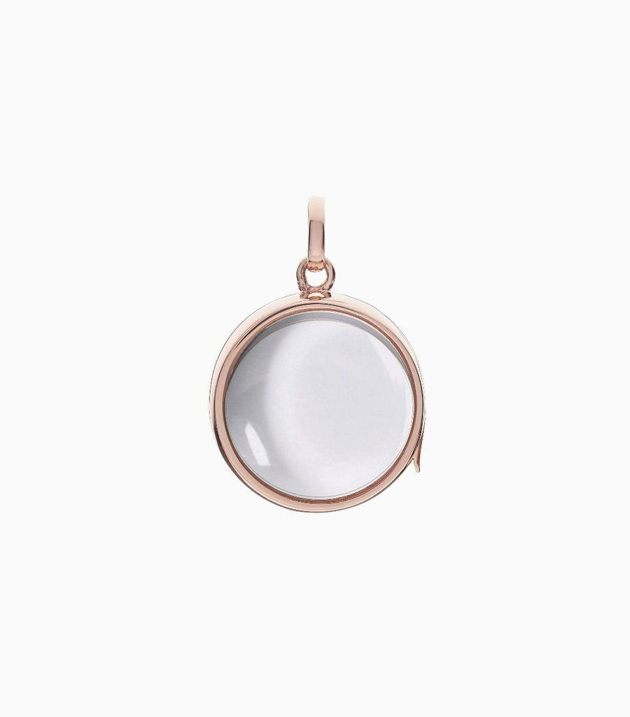 9carat rose gold, round shaped locket, set with a bevel edged, crystal glass front and a flat crystal glass back. The locket is designed with a side hindge for secure fastening and has a 18mm drop and a 17mm width