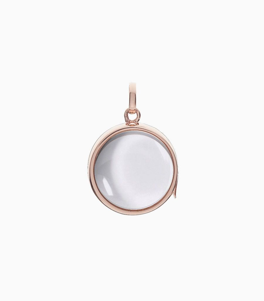 14 carat rose gold, round shaped locket, set with a bevel edged, crystal glass front and a flat crystal glass back. The locket is designed with a side hindge for secure fastening and has a 18mm drop and a 17mm width