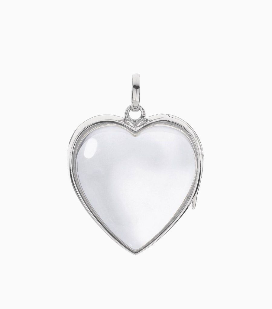 14carat white gold, heart shaped locket, set with a bevel edged, crystal glass front and a flat crystal glass back. The locket is designed with a side hindge for secure fastening and has a 24mm drop and a 22.5mm width