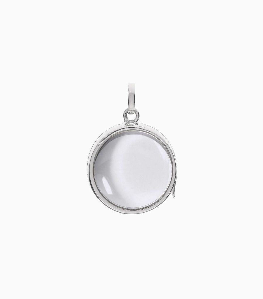 9carat white gold, round shaped locket, set with a bevel edged, crystal glass front and a flat crystal glass back. The locket is designed with a side hindge for secure fastening and has a 18mm drop and a 17mm width