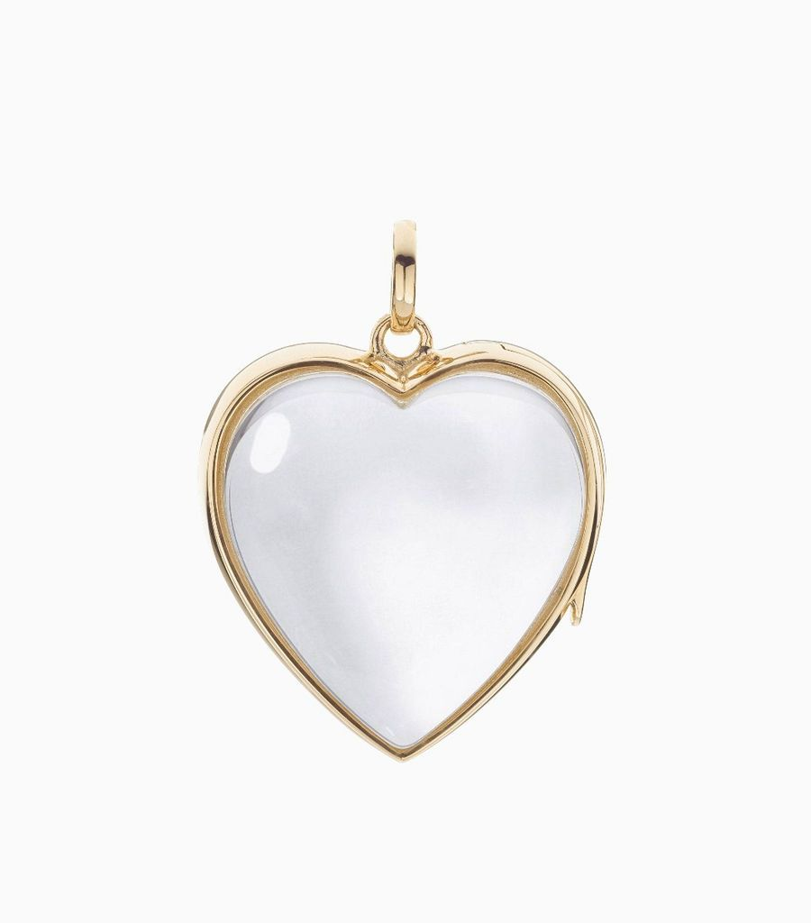9carat yellow gold, heart shaped locket, set with a bevel edged, crystal glass front and a flat crystal glass back. The locket is designed with a side hindge for secure fastening and has a 24mm drop and a 22.5mm width