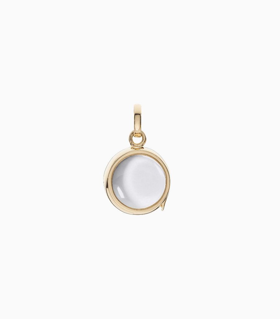9 carat yellow gold, round locket, set with a bevel edged, crystal glass front and a flat crystal glass back. The locket is designed with a side hindge for secure fastening and measures 12mm